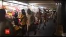 Десятеро чоловіків пробіглися голяка підземним переходом через програну суперечку