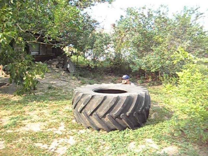 Упражнение с колесом от комбайна.