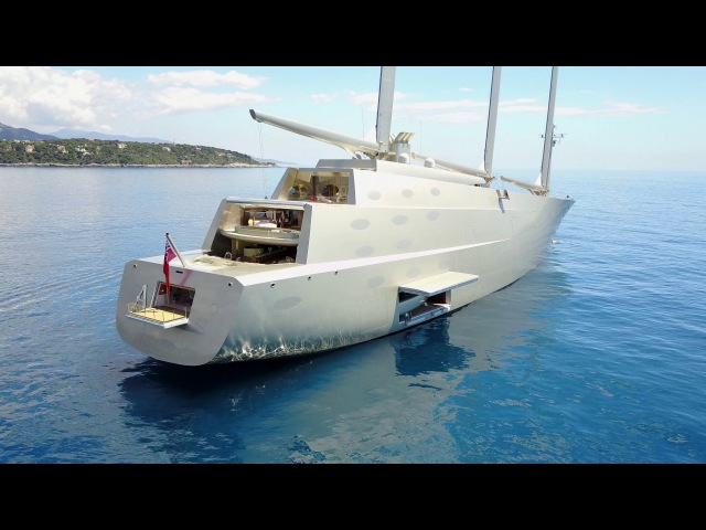 2 Yachts. $1 Billion - Exclusive Close up of Sailing Yacht and Motor Yacht A - 4k