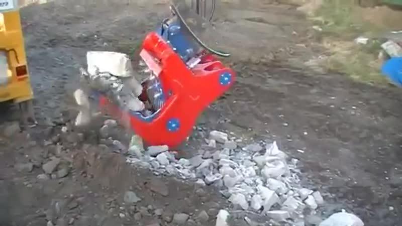 Экскаватор камнедробилка