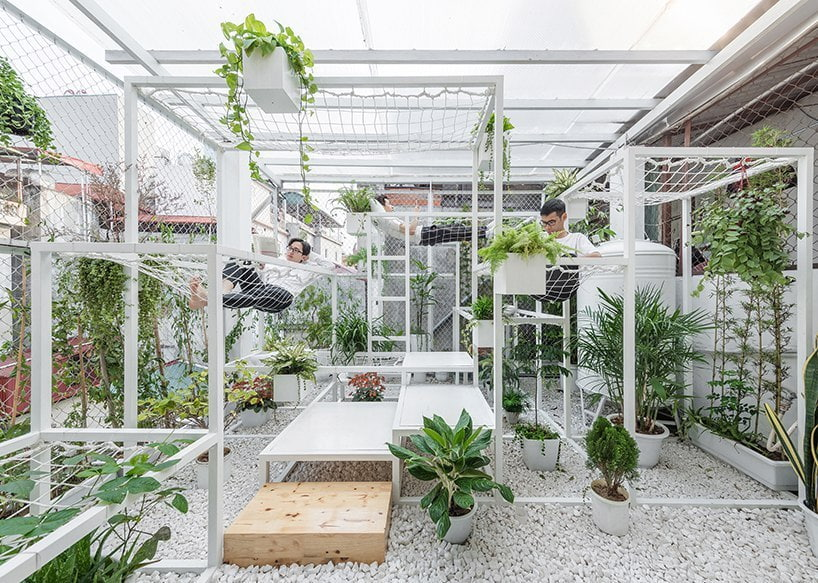 hung nguyen's eco-friendly pavilion in hanoi is adorned with air purifying plants