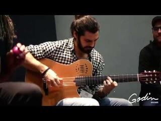 Luis Gallo, Mino Cinelu Javi Medina performing at the 2018 Godin Guitars NAMM showroom