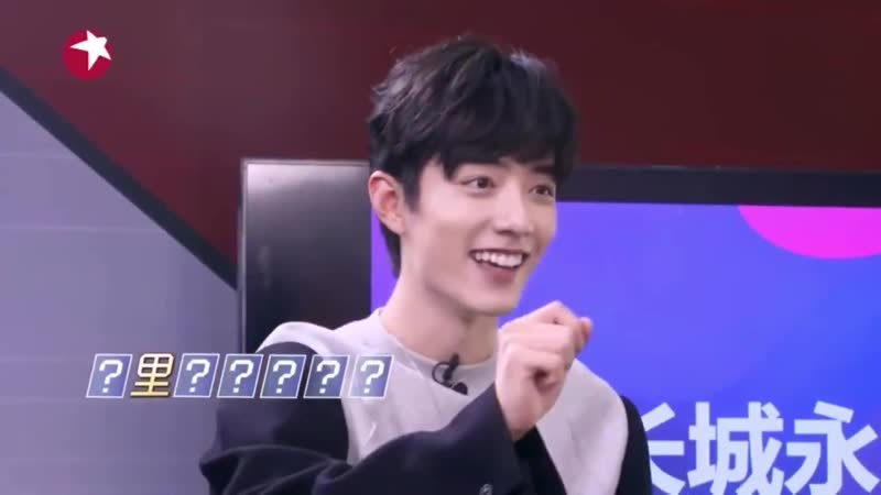 Xiao zhan playing guess the song name and he's so happy after just getting one word