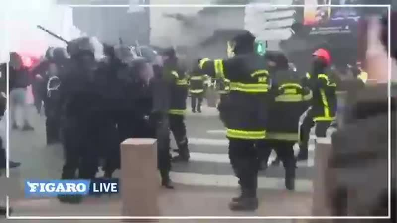 Footage has emerged of police smashing striking fire fighters with batons in France on Thursday.
