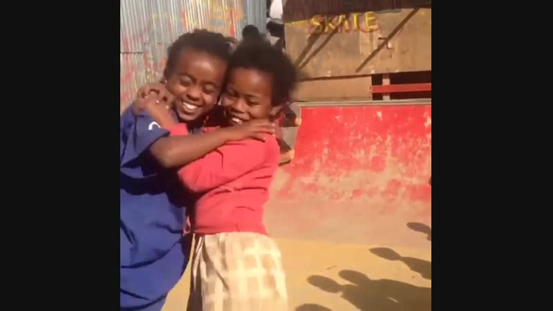 Two girls in close embrace as they skate together. Addis Ababa Ethiopia.