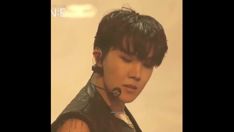 Jung Hoseok with black eyeshadow n all black outfit with sleeveless... unreal